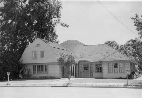 Black and white image of large house with 2nd story